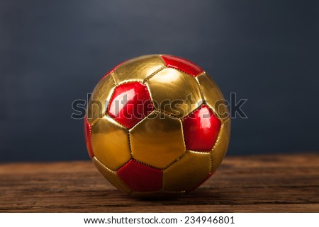 Ball on wooden table and blue background - stock photo