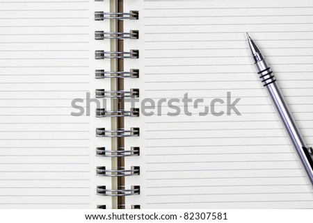 ball pen on Empty note paper page. - stock photo