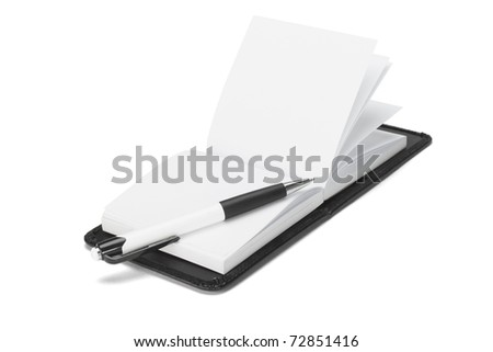 Ball point pen and open note pad on white background