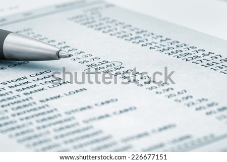 Ball point pen on Bank statement - stock photo