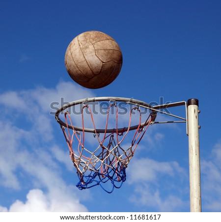 Ball ready to drop through the hoop - stock photo