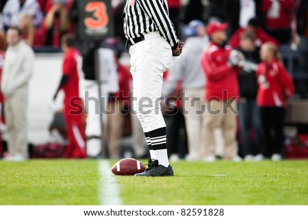 Ball resting on the Yardline at a Football Game - stock photo