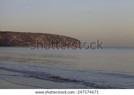 Ballard Down from Swanage beach in the evening light - stock photo