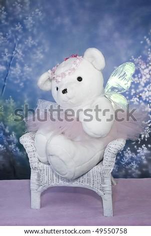 Ballerina/Angel Teddy Bear children's photo - bear sitting in a chair alone. - stock photo