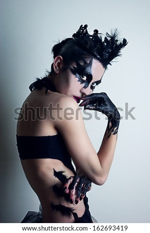 Ballerina. Black swan. Mysterious young woman. Fashion dark gotic makeup