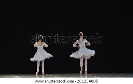 ballerina dancing in black background
