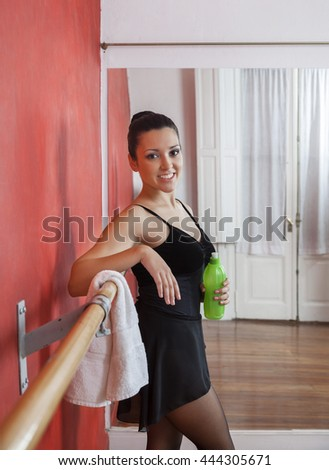 Ballerina Holding Waterbottle In Dance Studio