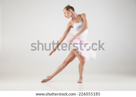 Ballerina in classical tutu over the white studio background - stock photo