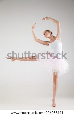 Ballerina in classical tutu over the white studio background - stock photo