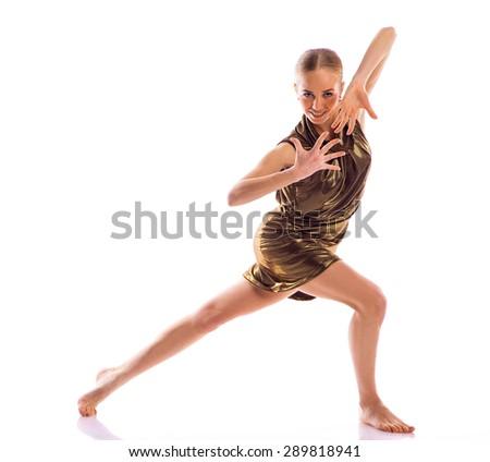 Ballerina in gold dress posing on white background in studio - stock photo