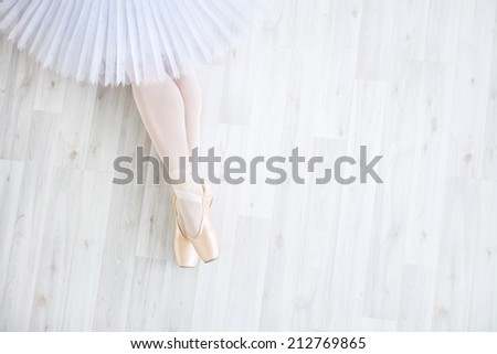 Ballerina in pointe in studio - stock photo