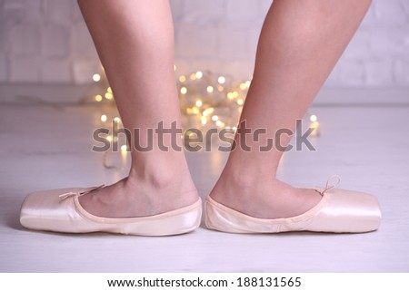 Ballerina in pointe shoes  in dance hall