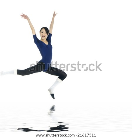 Ballerina jumping with reflection - stock photo