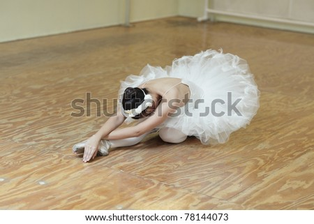 Ballerina performing stretches - stock photo