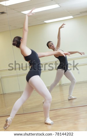 Ballerina practicing in the mirror - stock photo