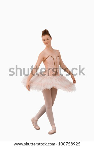 Ballerina standing against a white background