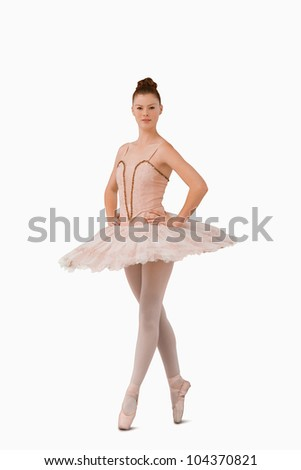 Ballerina standing on her tiptoes against a white background