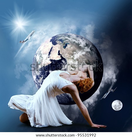 Ballerina stay in dancing pose on the Planet Earth. - stock photo