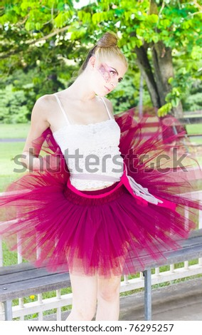 Ballerina Stretching And Warming Up Before Her Sports Dancing Exercise Fitness Performance - stock photo