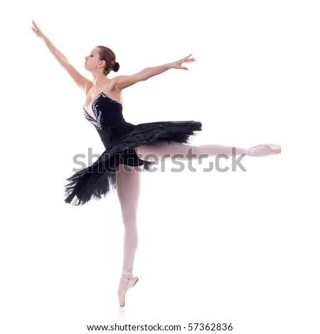 ballerina wearing black tutu posing on studio background - stock photo