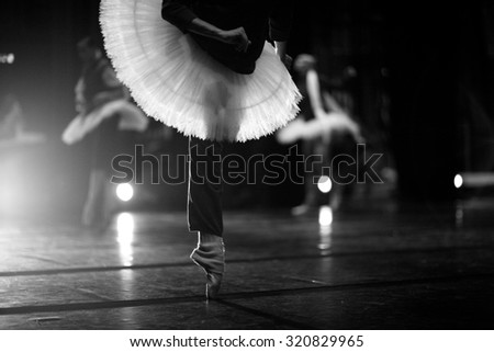 Ballerinas warming up backstage before show - stock photo