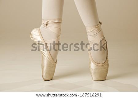 Ballet dancer feet - gold - stock photo