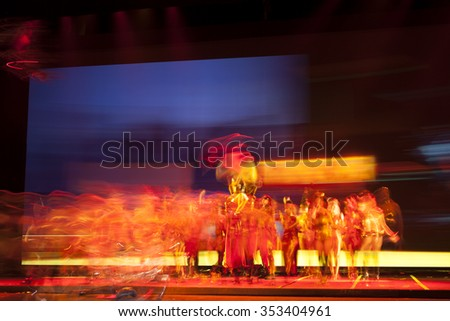 ballet dancers silhouettes Abstract Background  Blur.  Defocused entertainment concert lighting on stage.