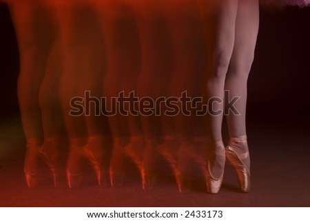 Ballet legs and toes with red light and motion blur - stock photo