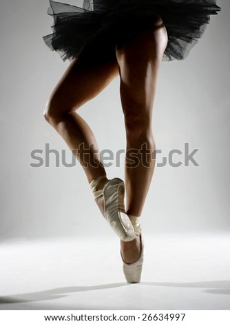 Ballet legs with black tutu - stock photo