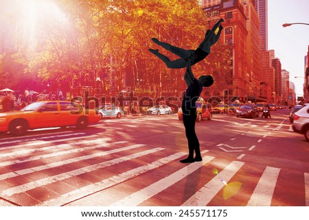 Ballet partners dancing gracefully together against new york street - stock photo