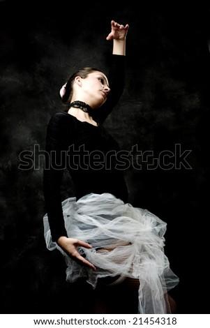 ballet pose, dark background - stock photo