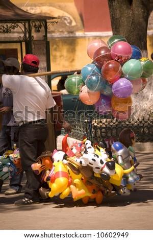 Ballon Vendor in a Plaza in Chiapas, Mexico - stock photo