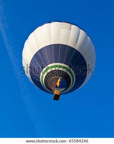 balloon against a backdrop of blue sky - stock photo