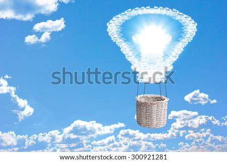 Balloon bulb made of clouds and sun bright in blue sky with ecology conception symbolizing the solar energy