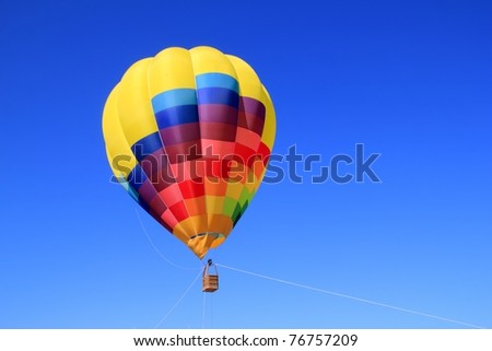 balloon colorful vivid colors in blue sky flying ship - stock photo