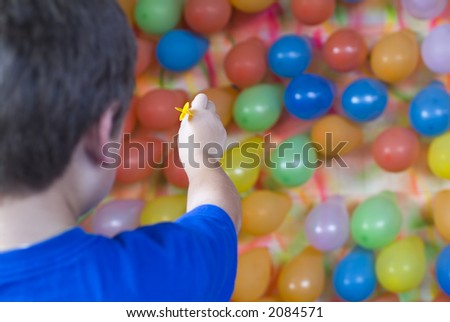 Balloon dart toss carnival skill game series - stock photo