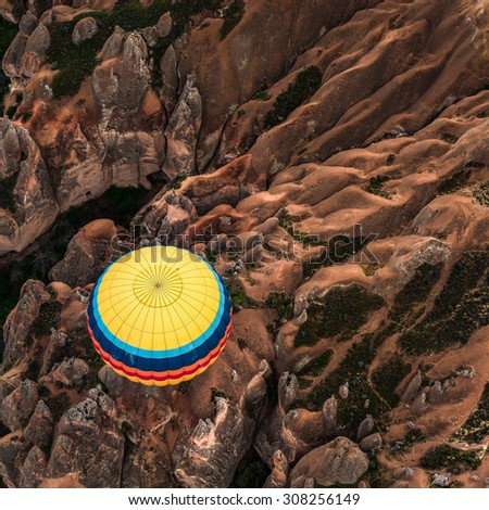 Balloon flight over ancient rock field at Cappadocia,Turkey. Cappadocia is the best places to fly with hot air balloons. Goreme, Cappadocia, Turkey  - stock photo