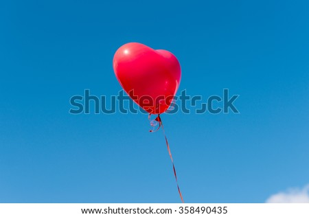 balloon heart on a background of blue sky - stock photo