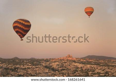 Balloon in Cappadocia over the ancient city - stock photo