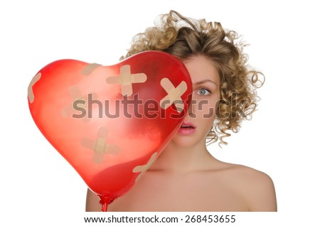 Balloon in shape of heart and upset woman isolated on white - stock photo