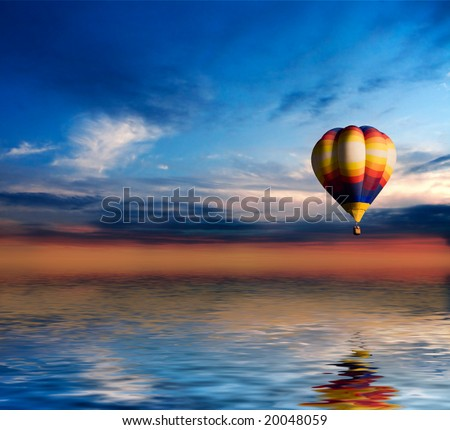 Balloon in sunset sky  fly over the sea - stock photo