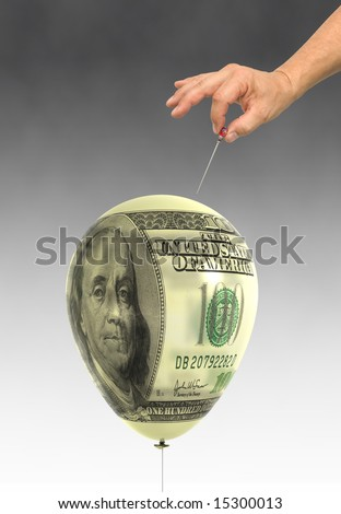 balloon printed with a hundred dollar bill about to be popped by a hand holding a hat pin - stock photo