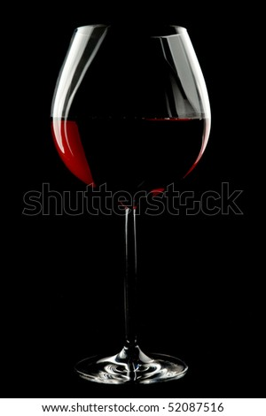 Balloon wineglass for bold,rich red wines over black backgroud. - stock photo