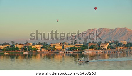Balloons above Luxor, Egypt, at dawn - stock photo