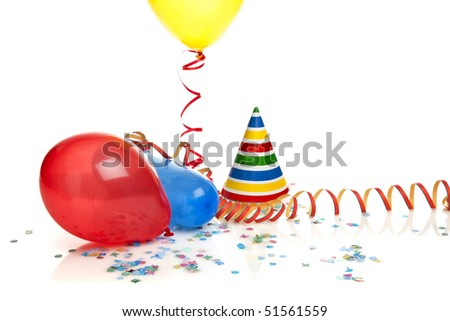 balloons, confetti, party hat and streamer on white background - stock photo