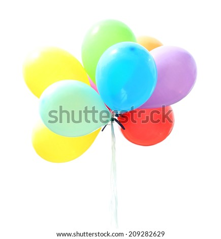 Balloons flying outdoors - stock photo