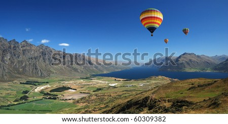 Balloons flying over the mountain - stock photo