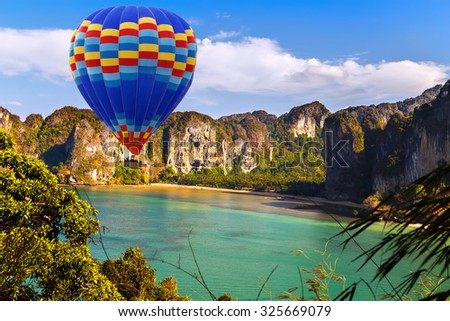 balloons landing in a mountain jungle island sea landscape