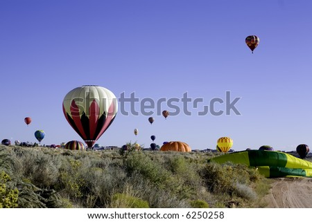 Balloons landing in Rio Rancho, NM - stock photo