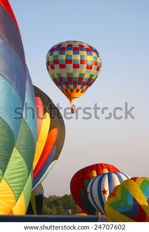 Balloons Launching into a Blue Sky